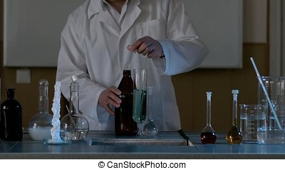 Water purification test. Drop blue liquid in test tube with...