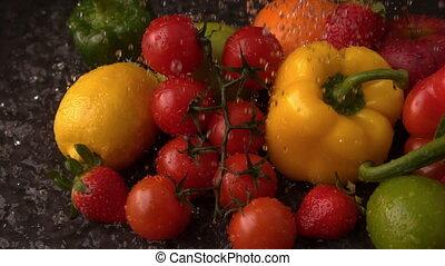 Water raining on selection of fresh produce - Water raining...