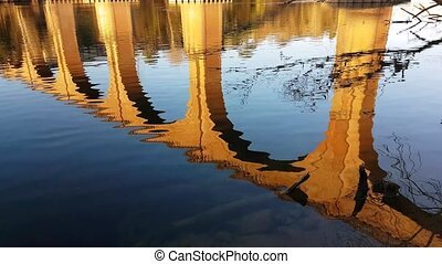 Water Reflection Of An Arch Bridge