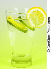 glass of water with lemons and limes