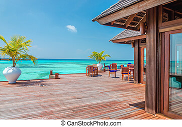 Water restaurant at the background of the blue sky in Maldives island