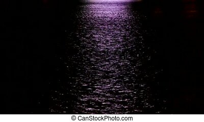 Water ripples reflection at night.