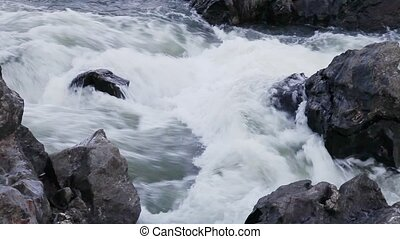 water running down a wild river