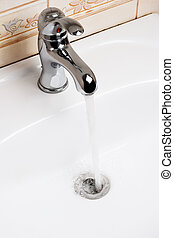 water running down from faucet