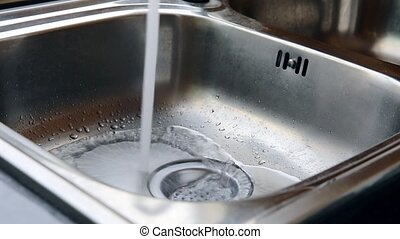 water running down the sink