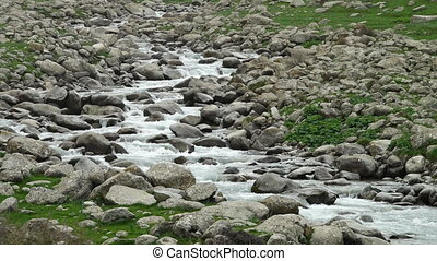 Water Rushing Down Rocky Hill - Steady, medium close up shot...