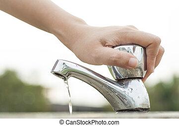 Water saving - Hand shuting faucet. Saving water concept