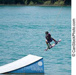 water ski  - A man water skiing on a lake