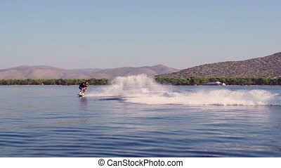 Water Skier In Action - Young Man Wakeboarding Jump On...
