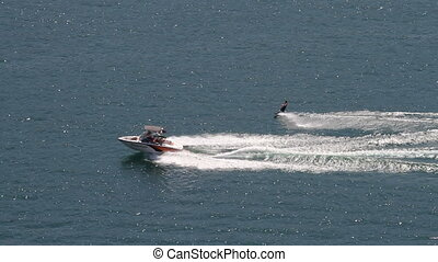 Water Skiing - Water skiing on summer lake