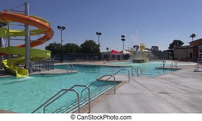 Water Slide Pool Summer - A view of all pool features water...