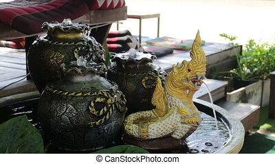 Water spay of mini naga statue, stock footage