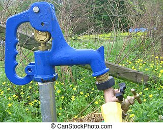a blue water faucet outdoor handle