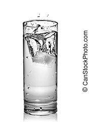 water splash in glass isolated on white