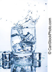 water splash in glass of blue color