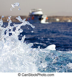 Water Splash with Sea Yacht at the Background