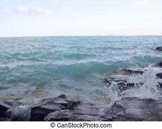 Water splashing against rocks