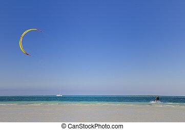 Water sport - Man doing water sport - windsurf in tropical ...
