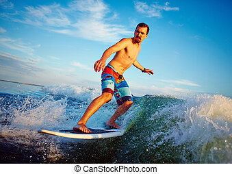Water sport - Young man surfboarding in summer