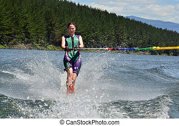 Water Sports - Water Skiing - A water skier woman water...