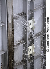 Water spraying through a leaky watergate