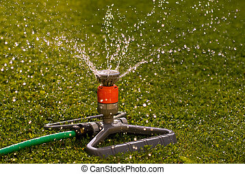 Water sprinkler - Close up of a sprinkler that spread water...