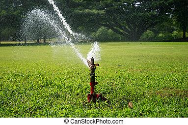 Water sprinkler in the park