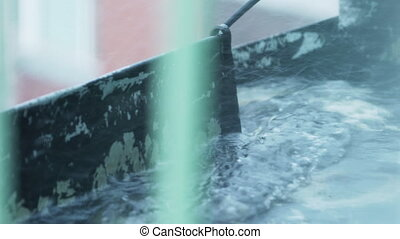 water stream on roof from heavy rain, uhd prores footage