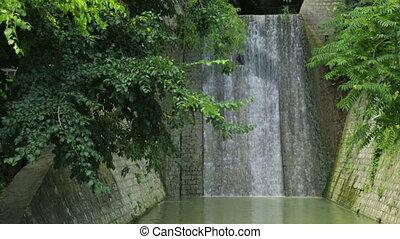 Water streaming down brick wall