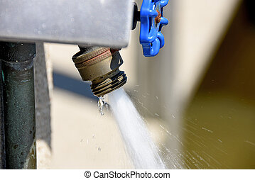 water streaming out of faucet - water spraying out of...