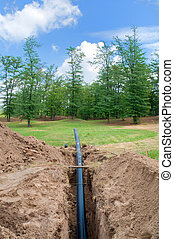 Ditch and tube for water supply at construction site