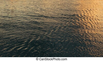 Water surface at sunset - view from moving cruise ship