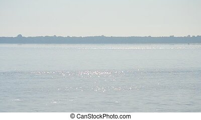 Water surface in a river or lake glittering in the sun