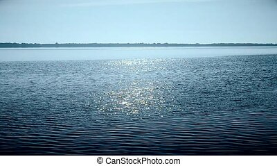 Water surface in a river or lake sparkling in sun