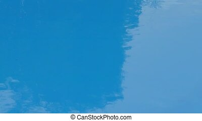 water surface in the pool with raindrops