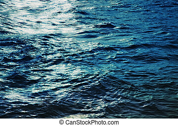 Water surface of the sea at night