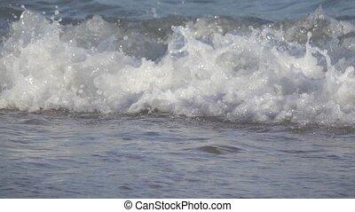 Water surface splashing in slow motion - Closeup of sea...