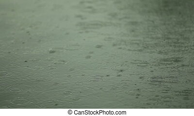 Water surface with raindrops