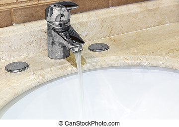 Water tap with a water stream