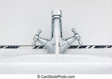 Water tap with a water stream.
