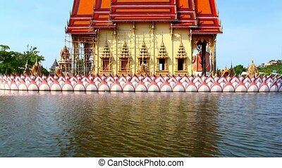 Water temple with reflection at Koh Samui, Thailand.