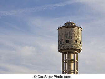 Water tower against the blue sky
