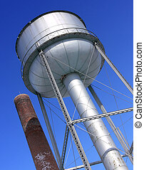 Water Tower and Chimney - Photo of a water tower next to a...