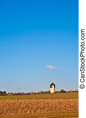 water tower in rural landscape