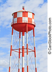 Water tower with red and white stripes