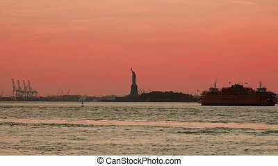 Water traffic on the Hudson River around Statue of Liberty, New York