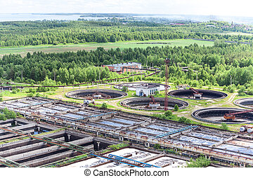 Water treatment plant area with round settlers and aeration basins