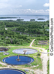 Water treatment plant in evergreen woods and blue lakes