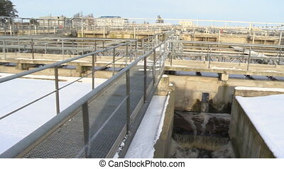 Water treatment waterworks facility basins pools and big tubes pipes. Panorama