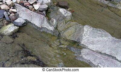 Water trickling down a rock three